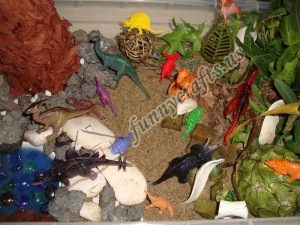 digging for dinosaur fossils sensory bin
