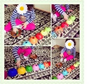 Sorting _toy_ pieces _by_ color_ using_ jumbo_ tweezers