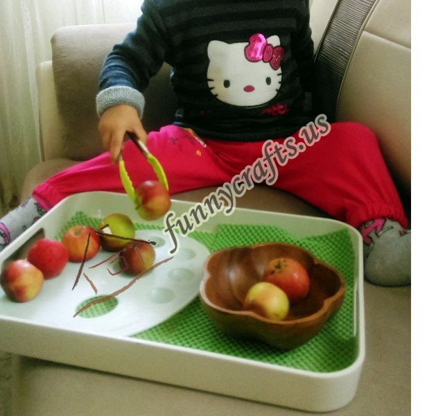 apple _transfer_ with_ tongs