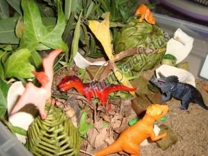 dinosaur and volcano sensory bin for kids