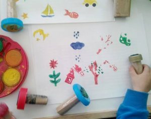 make stamps using bottle caps and foam stickers