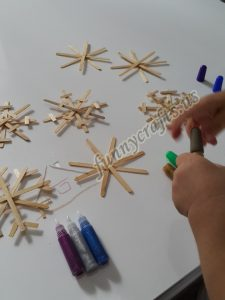 winter crafts colorful popsicle stick snowflakes